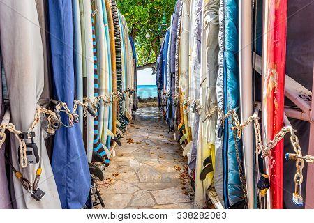 Waikiki, Hawaii/usa- Jan 25, 2019: Two Rows Of Colourful Surfboards Stored Off Waikiki Beach At The