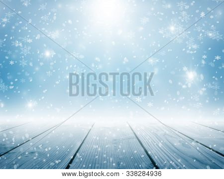 Snow Shines In The Sun. Blizzard. Winter Day. Blue Snowy Background. Frosty Winter Day. Sunrise. Sno