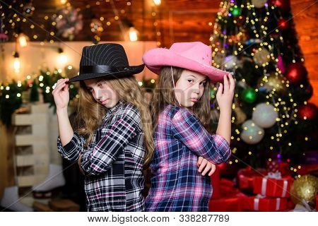 Christmas Party Concept. Girls Sisters Carnival Hats Costumes New Year Party. Kids Friends Celebrate