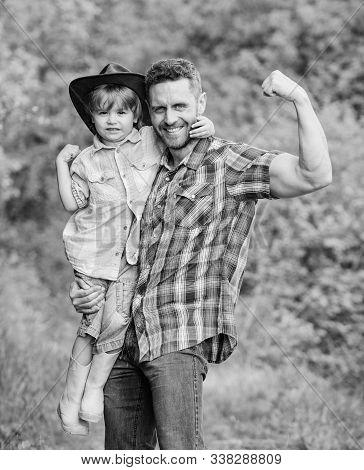 Child Having Fun Cowboy Dad. Rustic Family. Growing Cute Cowboy. Small Helper In Garden. Little Boy