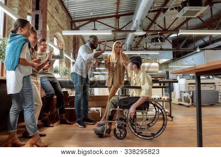 Portrait Of Mixed Race Business Team Having Coffeebreak. Young Co-workers In Casual Wear Welcome The