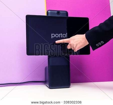 Paris, France - Oct 29, 2019: Woman Hand Pointing To Portal Smart Display By Facebook That Provide V