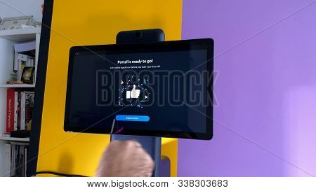 Paris, France - Oct 29, 2019: Man Hand Pressing Portal Ready To Go On Portal Smart Display By Facebo