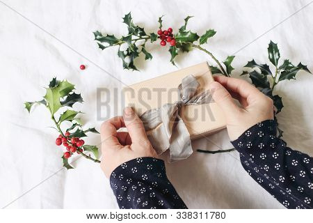 Closeup Of Womans Hand Holding And Wrapping Gift Box. Christmas Winter Design. Craft Concept. Femini