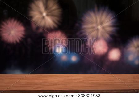 Wooden Board Empty Table In Front Of Blurred Colorful Fireworks