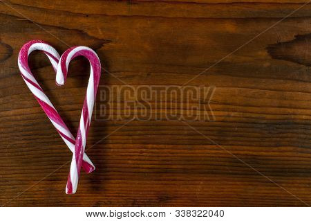 Heart Shaped Candy Cane On Wooden Background