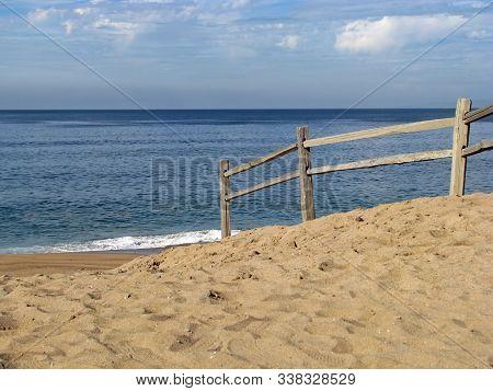 Fence On Sand Dune To Ocean On Monterey Bay Beach California