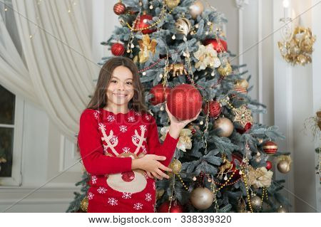 Have A Holly Jolly Xmas. Happy Child Hold Xmas Tree Ball. Little Girl Decorate Xmas Tree. Merry Xmas