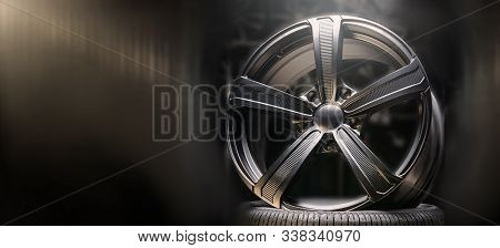 Beautiful Black Alloy Wheels Made Of Aluminum On A Dark Background. Exclusive Wheels For Expensive C
