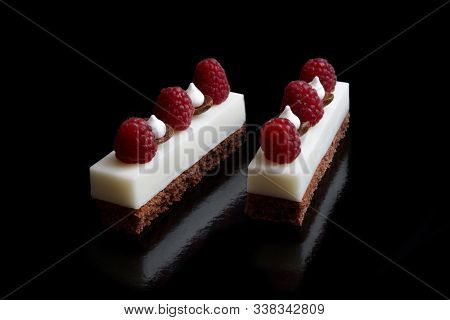 Two White Mascarpone Cheese Mousse Sheet Cake Slices With Raspberries And Meringues On Brownie Base