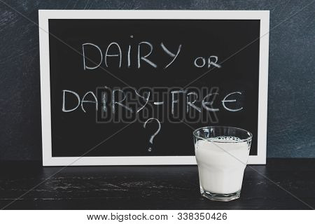 Dairy Or Dairy-free Debate, Text On Blackboard With Glass Of Milk From Topdown Perspective