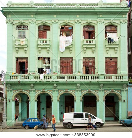 HAVANA-CUBA- DEC 5, 2018: Green colonial traditional house on the street in Centro Habana, one of the 15 municipalities or boroughs in the city of Havana, Cuba.