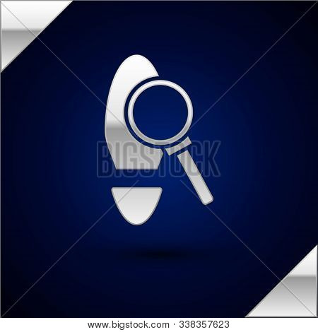 Silver Magnifying Glass With Footsteps Icon Isolated On Dark Blue Background. Detective Is Investiga