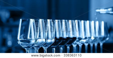 Wine Glasses In A Row. Pouring Wine. Buffet Table Celebration Of Wine Tasting. Nightlife, Celebratio