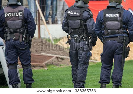 Police Officers. Police Forces Guarding Sport Match