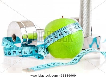 Dumbbells with an apple on a white background. A healthy way of life
