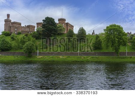 Inverness Castle Is A Red Sandstone Construction As Seen From Across River Ness , Scotland