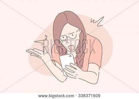 Anger, Frustration, Confusion Concept. Nervous Girl Looking At Smartphone Screen. Furious Teenager I