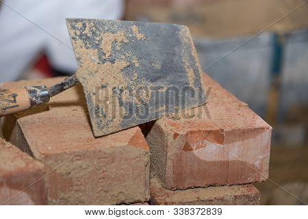 Trowel Laying Used On Bricks - Closeup Brick Zee And Smoothing Trowel