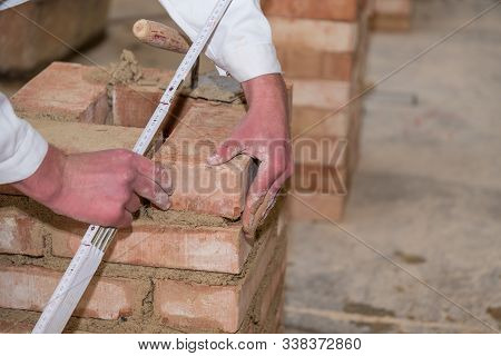 Craftsman Walls Brick Wall With The Help Of A Trowel And Folding Rule - Close-up