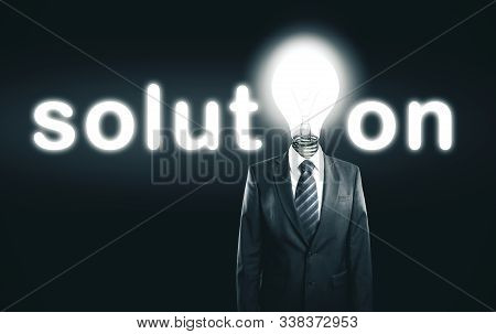 Businessman With Lightbulb Instead Of A Head. Business Solution And Success Concept.