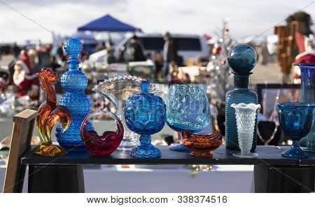 Stand With Colorful Vintage Glass At Flea Market.