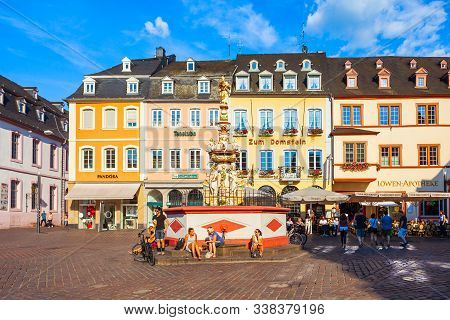 Trier, Germany - June 28, 2018: St. Peter Fountain At Market Square In Trier Old Town, Germany