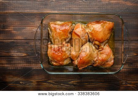 Homemade Baked Chicken Thighs With Soy Sauce And Spices In A Glass Tray. Copy Space