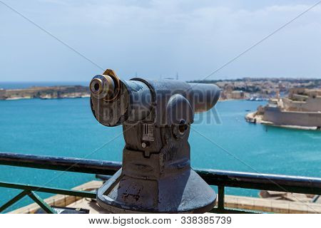 The Old Monocular For Tourists Points Out To The Seashore On A Sunny Day. Amazing Landscape Of The C