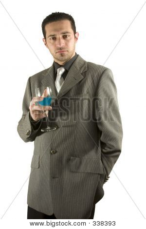 isolated businessman celebrating with a glass of drink ** Note: Slight blurriness, best at smaller sizes poster