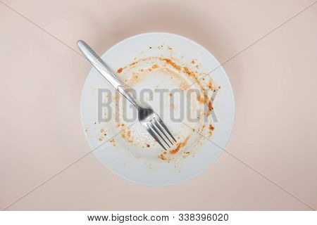 A Plate With Rests Of Tomato Sauce In It, Top View. Unwashed Dishes Illustration, Filthy Plate On Li