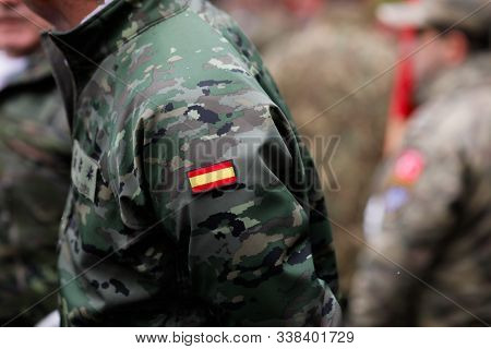 Details With The Uniform And The Flag On It Of A Spanish Soldier Taking Part At The Romanian Nationa