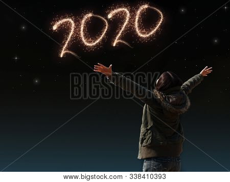 Happy Asian Girl Open Arm With Joyful On Countdown Night With Firework Light For 2020 Year. Image Of