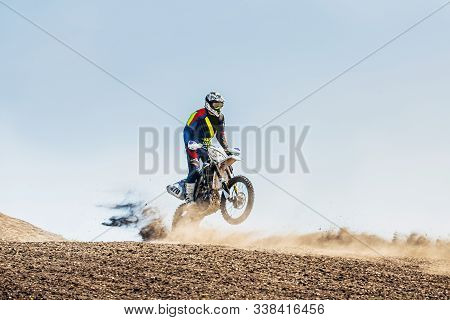 Motocross Rider Riding On Sport Trail In Dust And Dirt