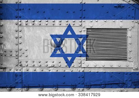Israel Flag Depicted On Side Part Of Military Armored Tank Closeup. Army Forces Conceptual Backgroun