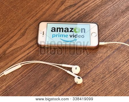 December 2019 New York: Amazon Prime Video Logo Icon On Smartphone Screen Close-up On Wooden Table.