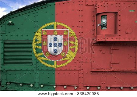 Portugal flag depicted on side part of military armored tank closeup. Army forces conceptual background poster