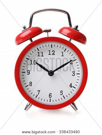 Close-up Of Red Vintage Round Alarm Clock. Antique Snooze Points Ten Minutes To Eleven. Reminder And