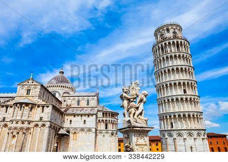 Pisa Leaning Tower And Pisa Cathedral At Piazza Dei Miracoli Or Square Of Miracles In Pisa, Italy