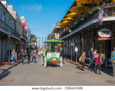New Orleans, Louisianna, Usa. December 2019. People Visit Historic Building In The French Quarter In