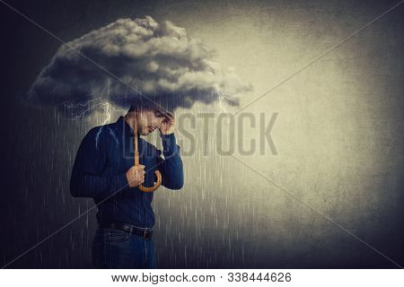 Pessimistic Man, Standing Under Rain, Suffering Anxiety As Holding An Umbrella Thunderstorm Cloud Ov