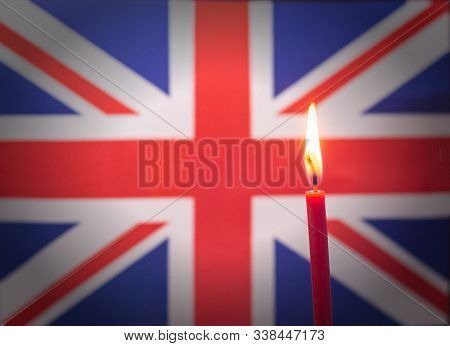 Burning Candle On The Background Of The Flag Of United Kingdom. The Concept Of Mourning And Sorrow I