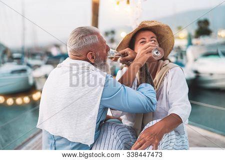 Senior Couple Date Drinking Champagne On Sailboat Vacation - Happy Elderly People Having Fun Celebra