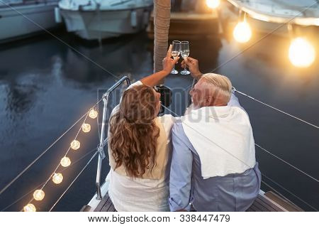 Senior Couple Toasting Champagne On Sailboat Vacation - Happy Mature People Having Fun Celebrating W