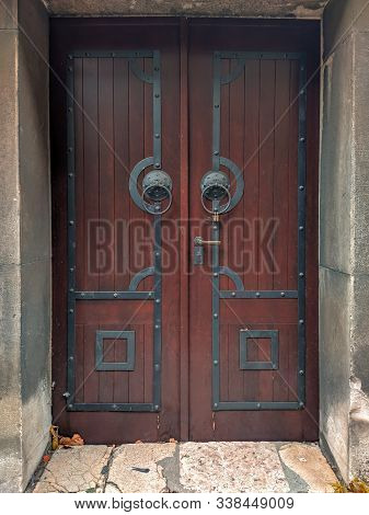 Cool Looking Ancient Old Closed Wooden Door In Reddish Color With Metal Ornaments And Retro Style Ha