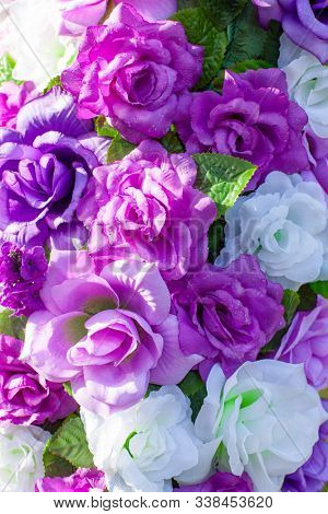 bouquet of purple white and pink roses