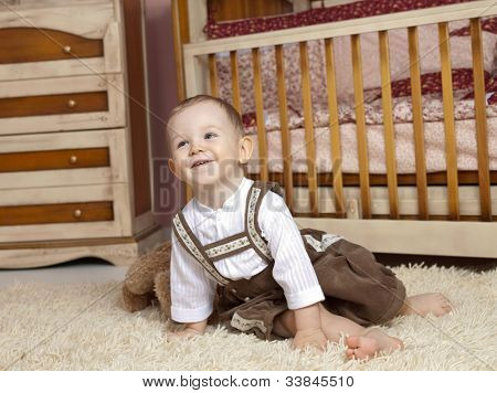 little child baby boy happy smiling cheerful indoors babyroom toy