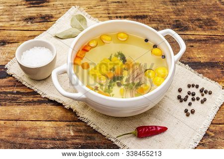 Transparent Duck Broth With Dumplings And Vegetables. Traditional Bouillon, Healthy Food. Old Wood B