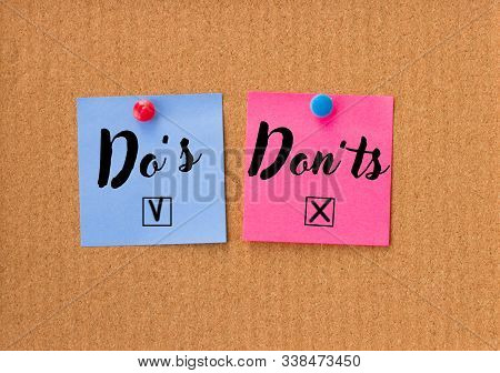 Dos And Donts On Blue And Pink Empty Notes On Cork Background