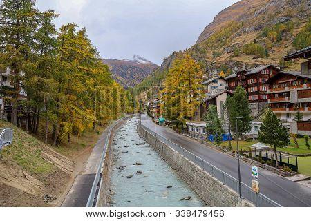 Zermatt, Switzerland-october 21, 2019:the Old Building On Zermatt Bahnhofstrasse Street In Autumn An